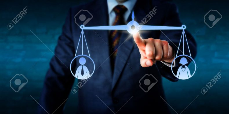 41068708-business-manager-touching-a-virtual-weighing-scale-to-balance-out-one-female-and-one-male-office-wor